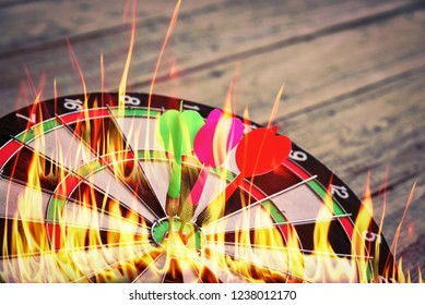 Red green Darts on Dartboard at wall of wooden with frame, Business investment that rely on precision away be alert to success so game,