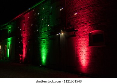 red and green dj ambient lighting design on a barn at a vintage wedding