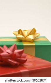 Red and green gift boxes. Selective focus. White background.