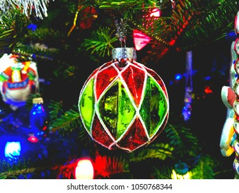 Red and green glass holiday Christmas tree ornament.
