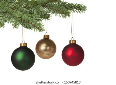 Red, green and gold baubles hanging on Christmas tree for holiday background. With copy space.