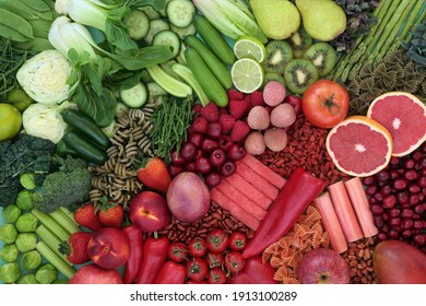 Red and green high fibre food for gut health concept with fruit, vegetables, pasta and legumes with super foods also high in antioxidants, smart carbs, anthocyanins, lycopene , minerals and vitamins.