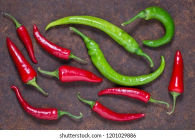 red and green hot chilli peppers on dark background. Top view