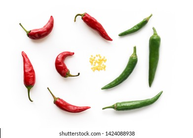 Red and Green hot chilli peppers with seed. Food background. Top view.