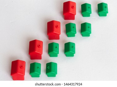 Red and green houses isolated on white background.