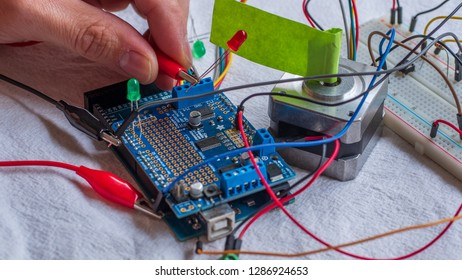Red and green LED lights being shown in use as part of a microcontroller build