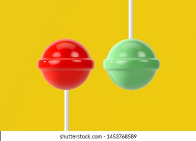 Red and green lolipop on yellow pastel background.sweet candy concept