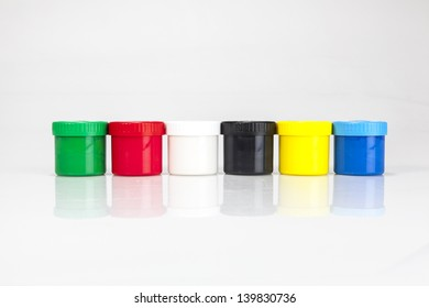 red and green paint boxes with brushes on white background