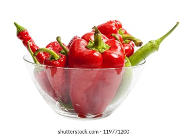 Red and green pepper in salad dish isolated on white