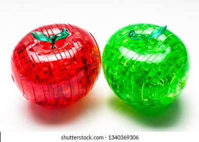 Red and green plastic apples-puzzles