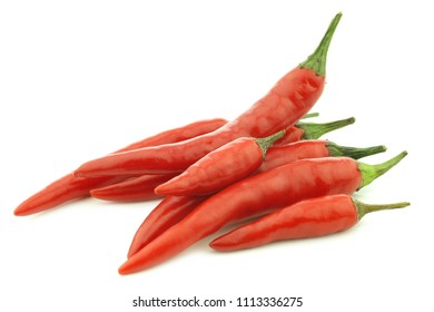 red and green rawit peppers (Capsicum annuum 'Bird's Eye') on a white background