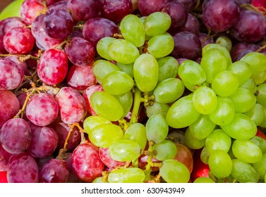 Red and green ripe grapes close up, fruit, background, selective focus
