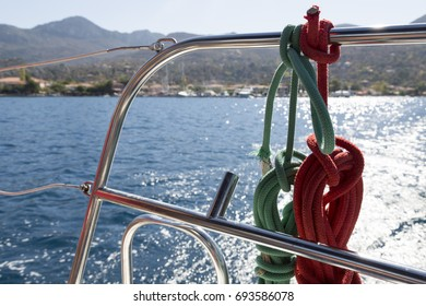 Red and green sailing ropes on boat. Port and starboard colors
