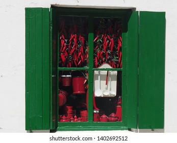 Red and green. Spanish specialities. Window with peppers and dishes. Picture taken in Hondarribia, Spain, Basque countries.