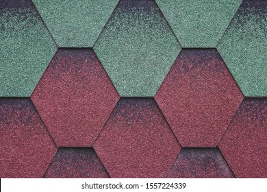 Red and green surface of roofing tiles. Cover of shape of rhombus. Dark roof tile, grunge background. Abstract mosaic of bricks background. Grunge wall texture.