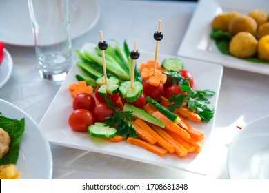 red and green vegetables on a white plate