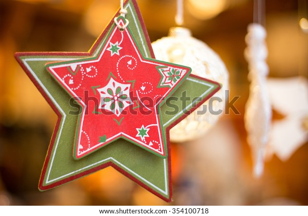 Red and green wooden  craft Christmas star - perfect christmas background, nice, sincere and shiny