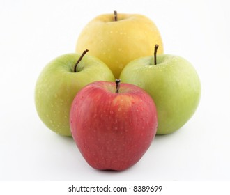 Red, green and yellow apples on white background