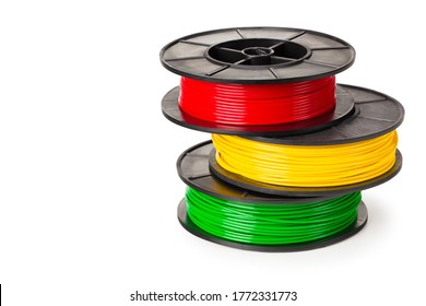 red, green, yellow filament for 3d printer isolated on white background
