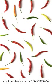 Red, green and yellow hot little chili peppers pattern on white background. Top view. Flat lay