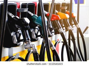 red green yellow orange color fuel gasoline dispenser  background energy crisis