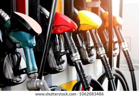 red green yellow orange color fuel gasoline dispenser  background