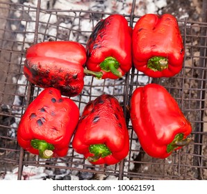 Red grilled pepper on bbq fireplace