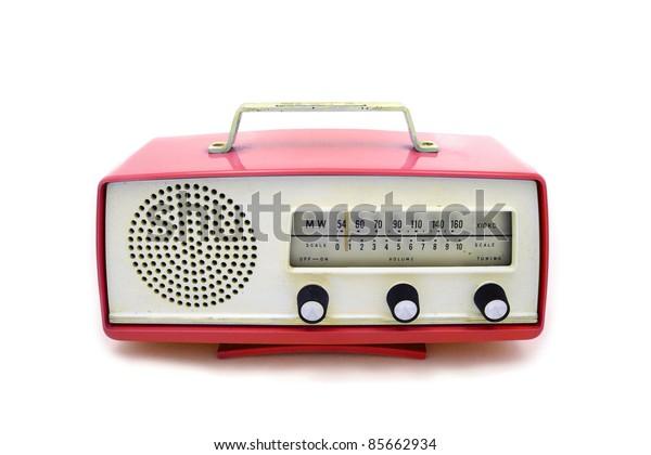 Red grungy retro radio on  isolated white background