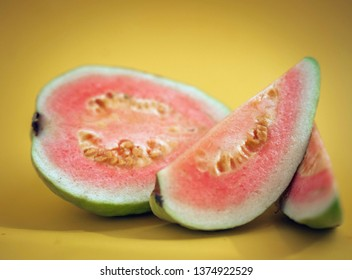 Red guava on a yellow background
