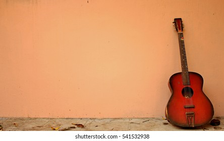 Red Guitar Lying Silently