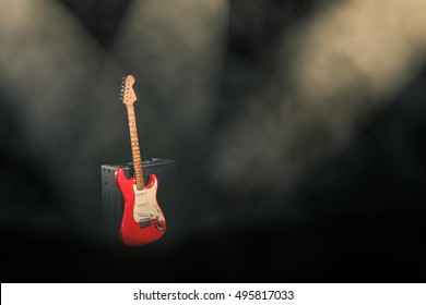 The red guitar on stage.