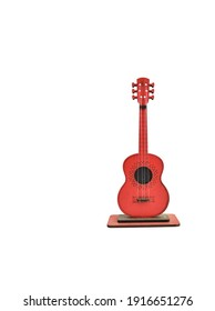 Red guitar on white background