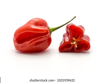 Red Habanero chili with one half isolated on white background hot Chinese pepper