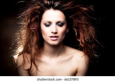 red hair beautiful woman portrait, studio shot dark background