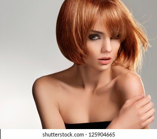 Red hair. Beautiful Woman with Short Hair. High quality image.