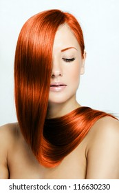 red hair , beautiful young red-headed woman with long shiny hair , hairstyle
