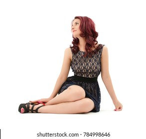 Red hair beauty looking up on white background