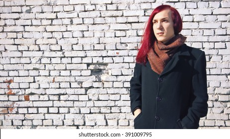 Red hair boy captured on white wall front.