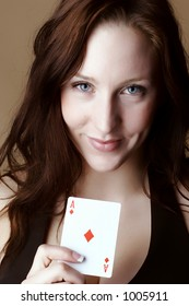 Red Hair female holding an Ace of Diamonds