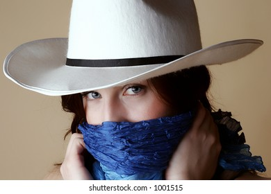 Red hair female wearing cowboy hat and bandanna