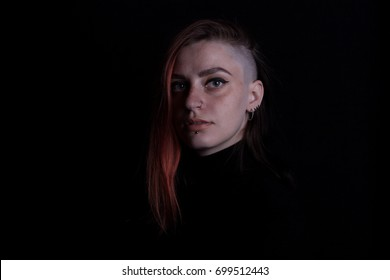 red hair witch with tatoo posing in studio