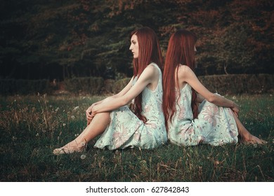 Red hair woman back to back with herself. Surreal and conceptual