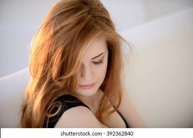 red hair woman is looking away