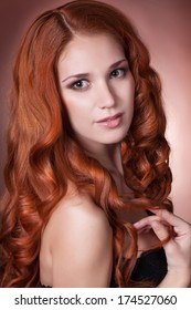 Red Hair woman with perfect skin. Spa, skincare, cosmetology, beauty model, clean skin. beauty woman with red curly hair. Ginger girl. studio. isolated.