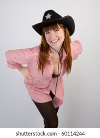 Red haired cowgirl looking to the camera