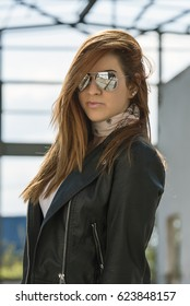 Red haired girl with sunglasses posing
