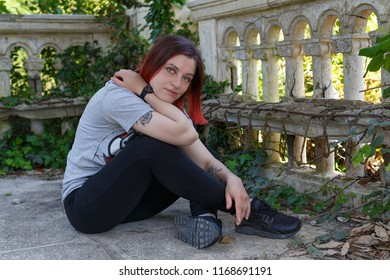 red haired goth girl travelling in abandoned Abkhazia