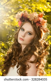 Red haired long hair girl in autumn park Beautiful girl in autumn forest. Beautiful elegant red hair girl standing in a park in autumn. Outdoors portrait of beautiful girl with red hair and blue eyes
