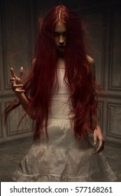Red haired zombie woman in white cotton dress