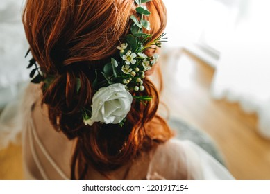 Red hairstyle with wreath